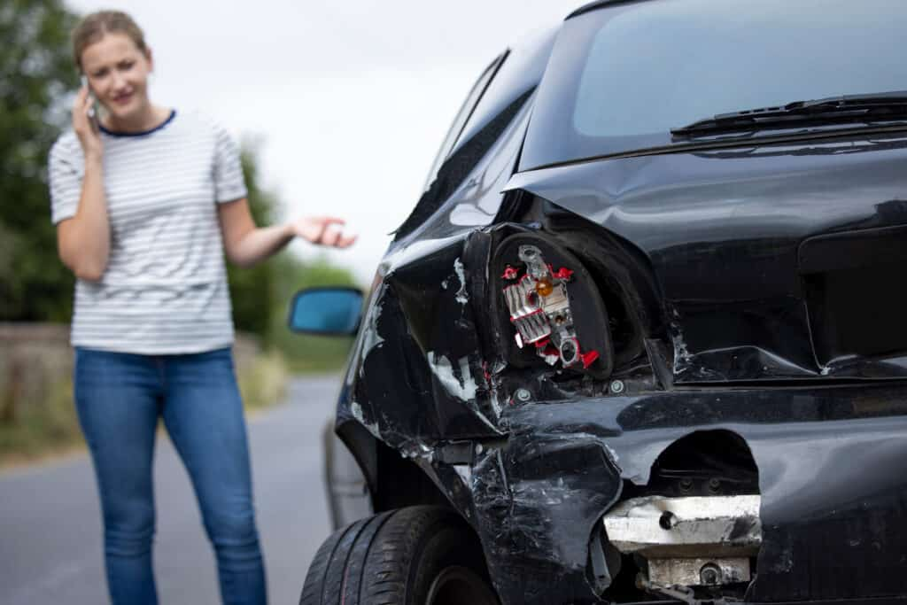 woman figuring out what to do after a car accident